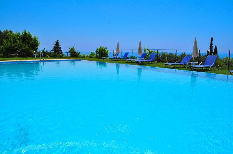 Escape luxury apartment by the pool - Pelekas Beach, Corfu, holiday rental in Pelekas