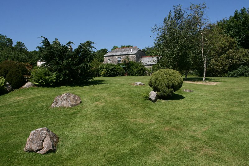 View of the barn from the garden. Hollyhock is located on the ground floor.