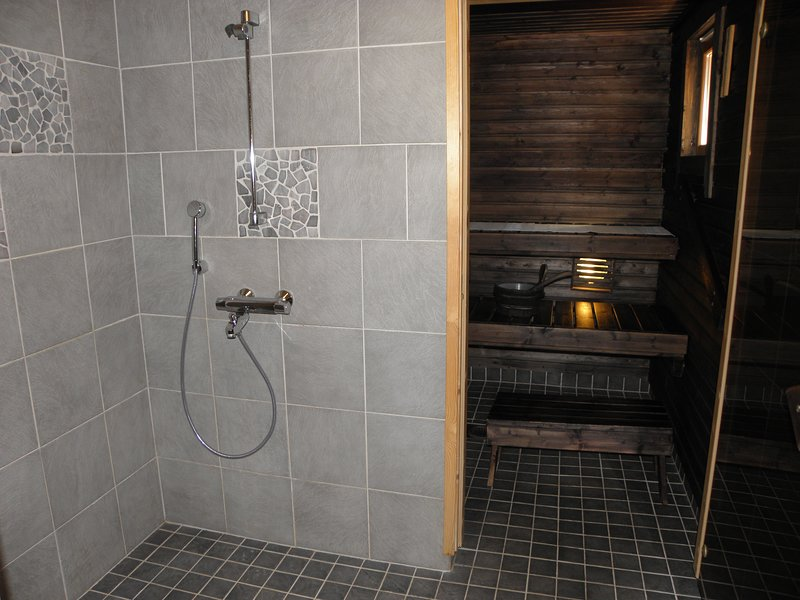 The bathroom and a sauna with a wood-stove