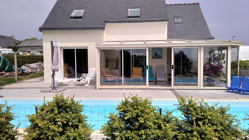 Front of the house with veranda and heated pool