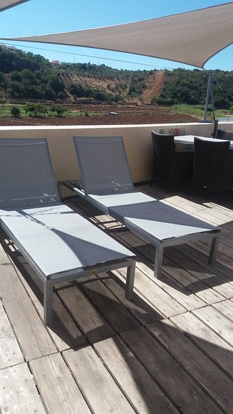 Comfy sun loungers and a dining