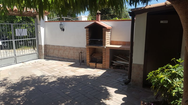 Court with barbecue and hot water shower.