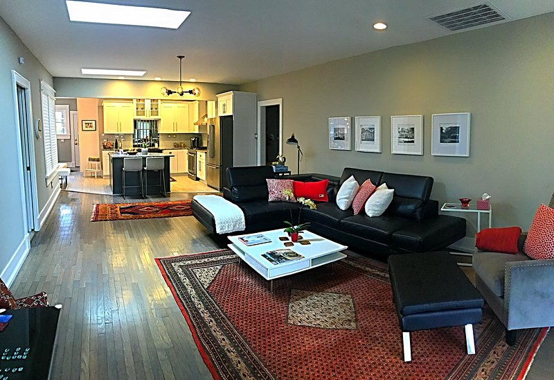 A view of the living area, with the kitschen in the background -- open concept