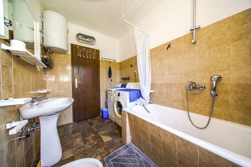 A1 (5 + 1): baño con inodoro.