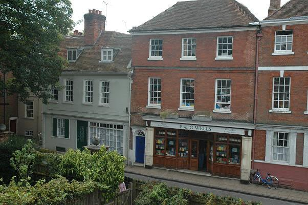The flat is on the top floor above a bookshop in a quiet street.  Street parking permit included