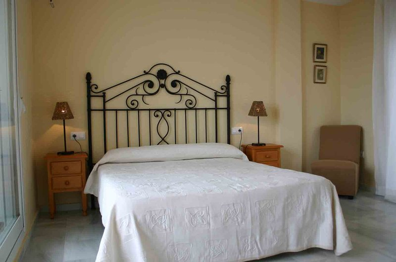 Main bedroom with bathroom ensuite and large terrace with sea views