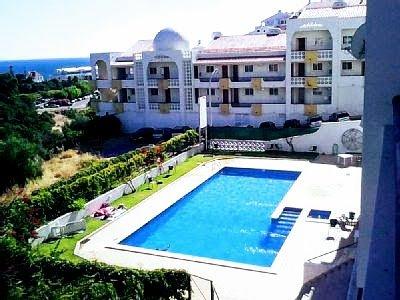 View pool, garden & sea from balcony