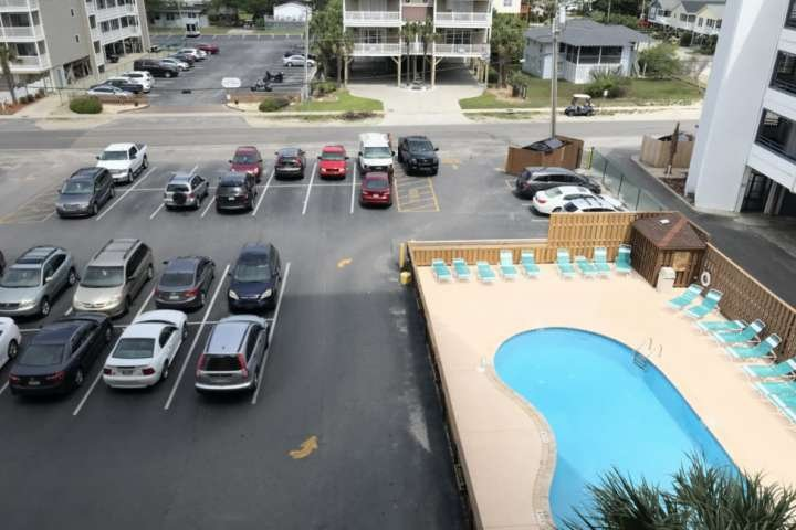 Pool and parking lot view. Only two parking passes are allowed