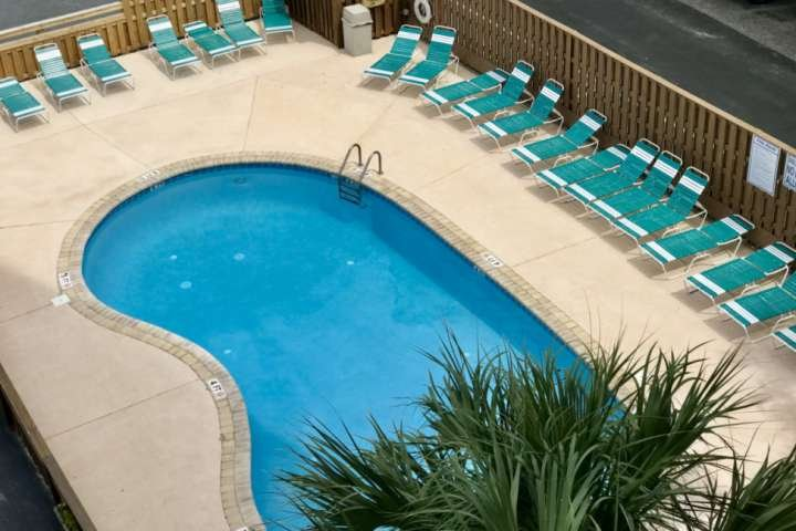 View of the pool from the 4th floor hallway