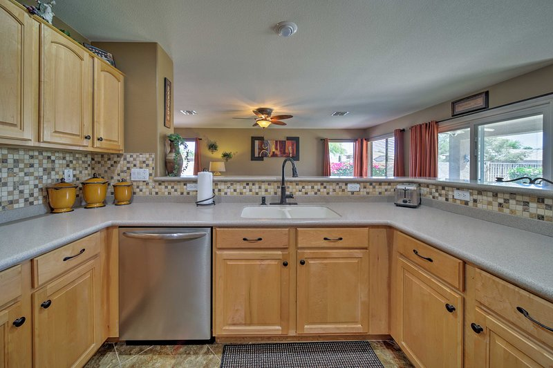 Stainless steel appliances and ample counter space make cooking a breeze.