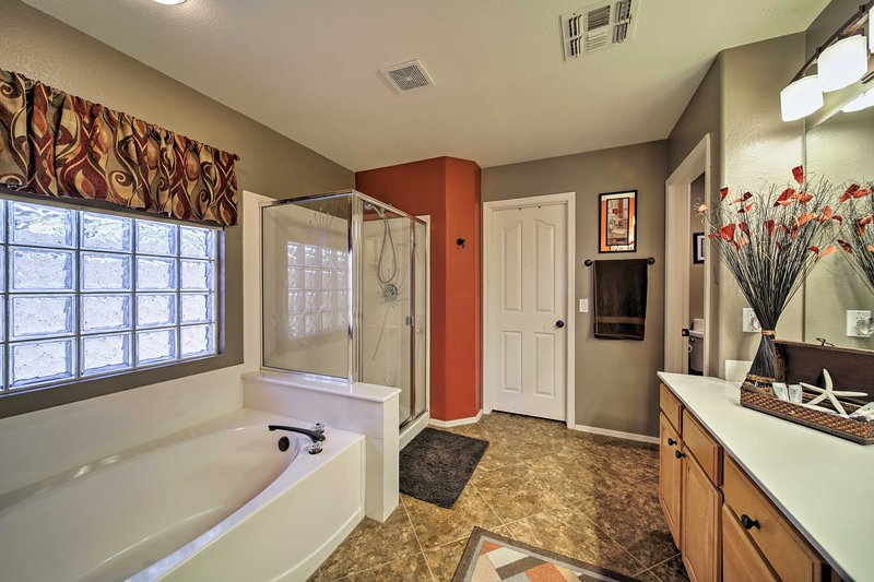 Rinse off in the shower or soak in the tub in the master en-suite bathroom.