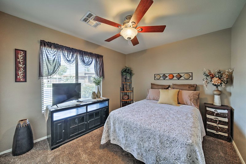 The third bedroom features a full bed and flat-screen cable TV.