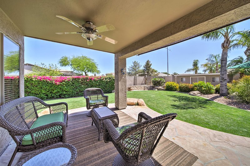 Sip your morning coffee on the covered patio featuring outdoor furniture.