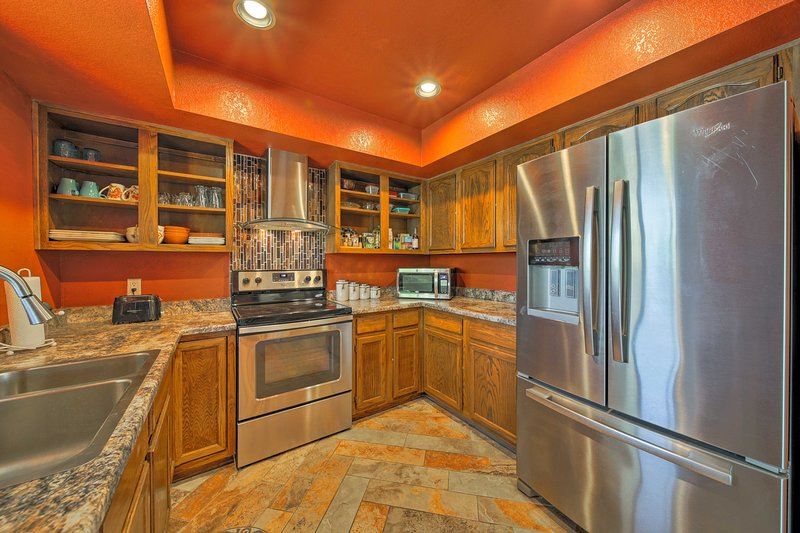 Stainless steel appliances are perfectly complemented by the granite countertops.