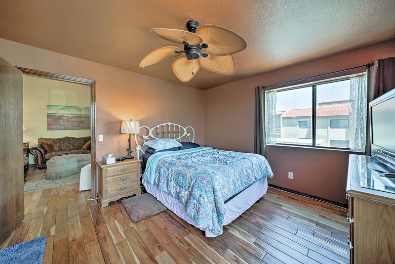A peaceful night's sleep awaits in the first bedroom with a queen bed for 2.