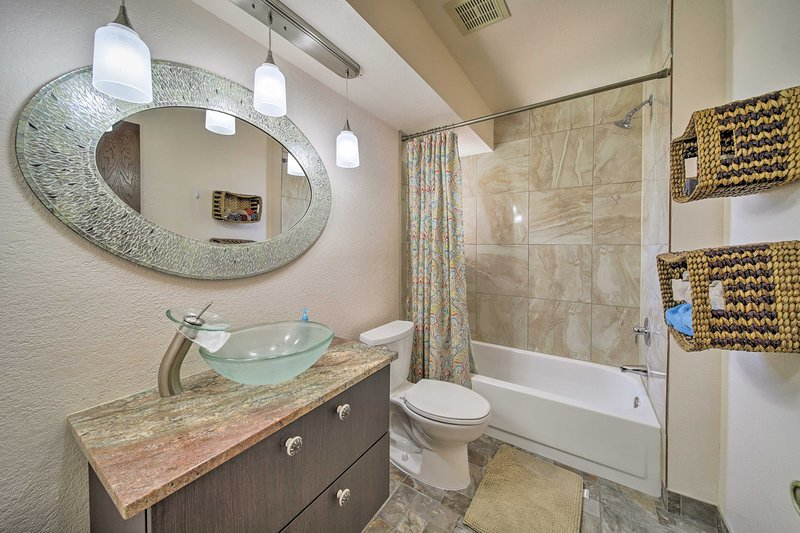 Both of the condo's 2 bathrooms come stocked with fresh towels.