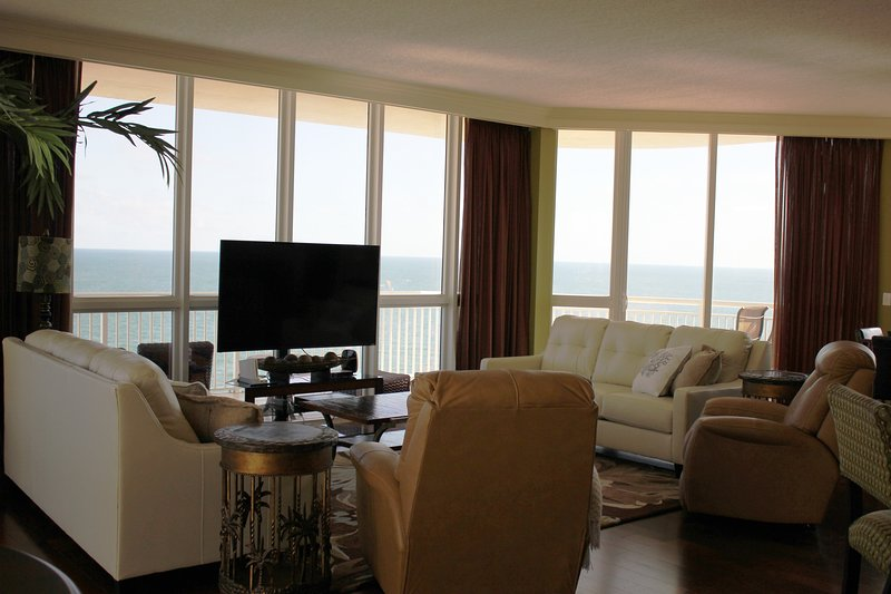 Living room has a full glass window 180 degree panoramic beach front view of the Gulf.