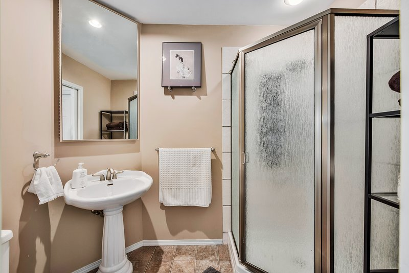 Master ensuite bathroom with an amazing messaging heads shower