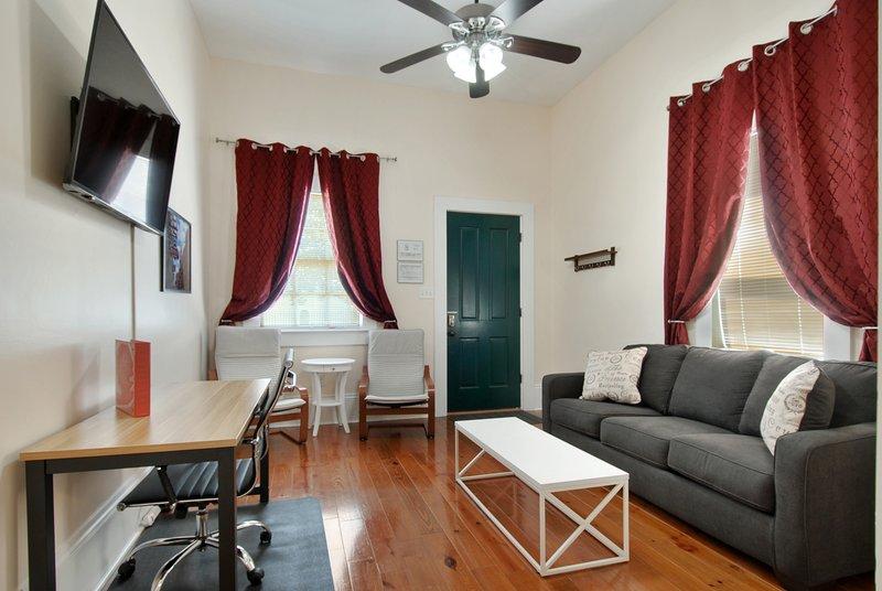 Living room. 50' smart tv, queen sleeper sofa, desk.