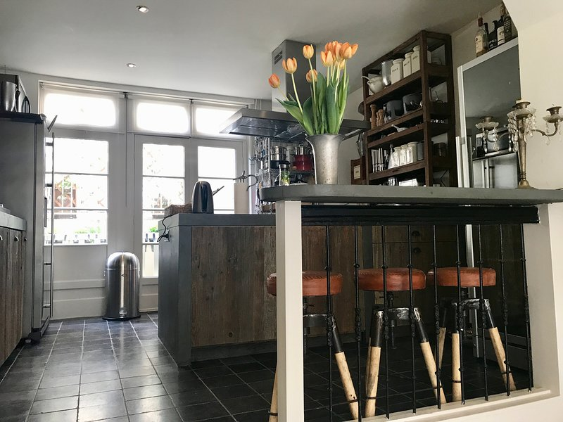 The kitchen and bar are situated on the split level