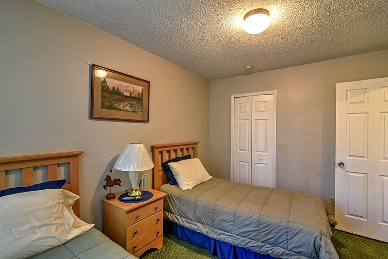 The guest bedroom has 2 twin beds and it's own private bathroom access.