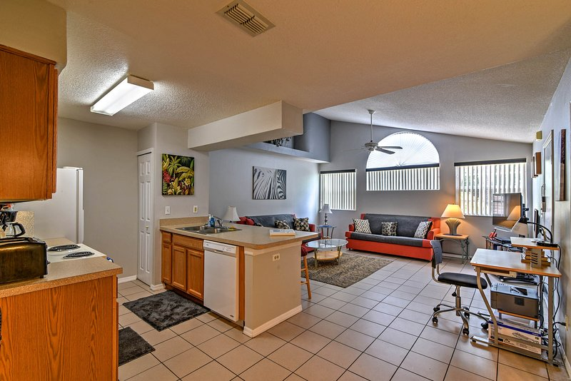Enjoy pristine ceramic tile floors, bright windows and a high vaulted ceiling.