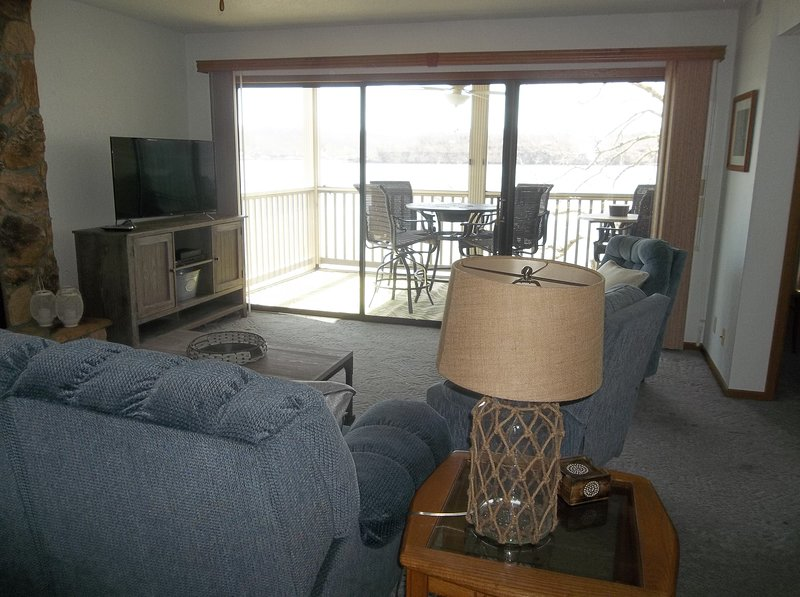 Great view of lake from living room as well.  Plenty of seating, Flat screen TV