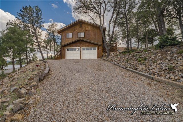 Gravel drive and garage available for guest use.