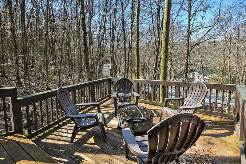 This cabin home features 2 bedrooms, 1 bath and multiple decks.
