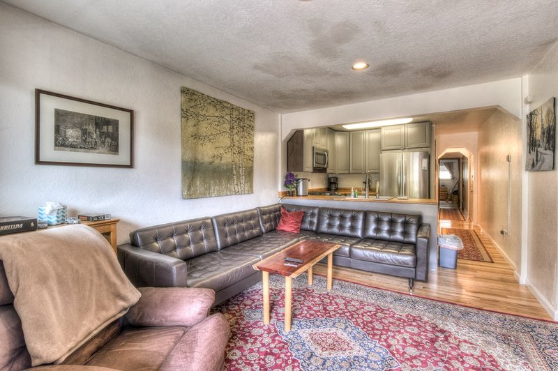 Living room with large sectional couch for plenty of seating