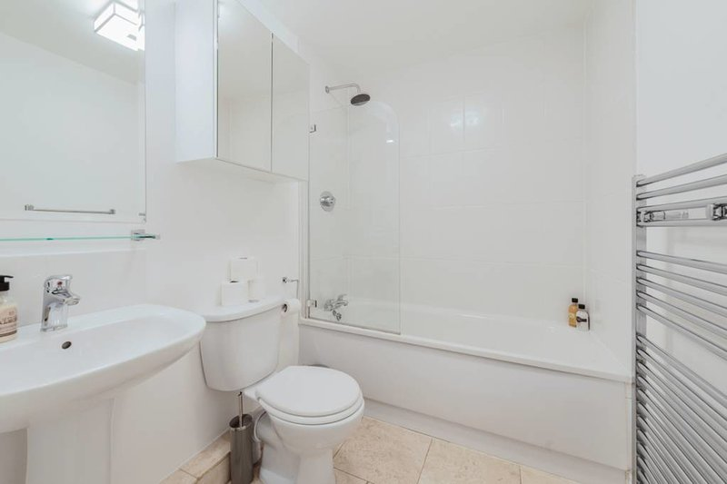 A bathroom stocked with fluffy white towels and toiletries...