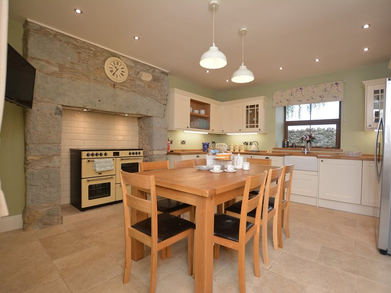 Stylish kitchen with TV and thoughtful little extras