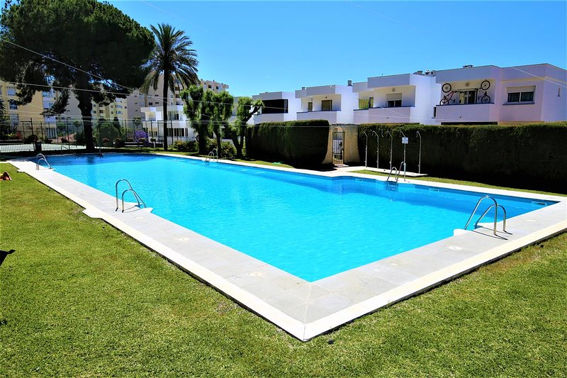 Large community swimming pool only a short walk away