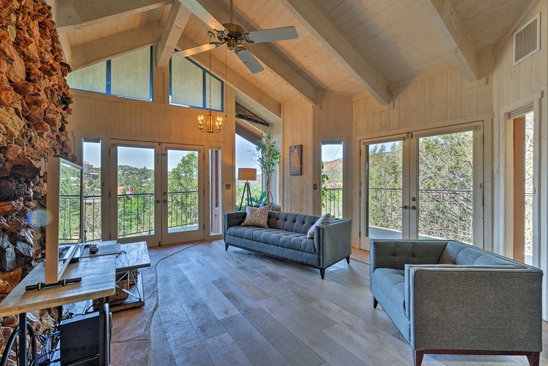 Upstairs, vaulted ceilings frame the main living space.