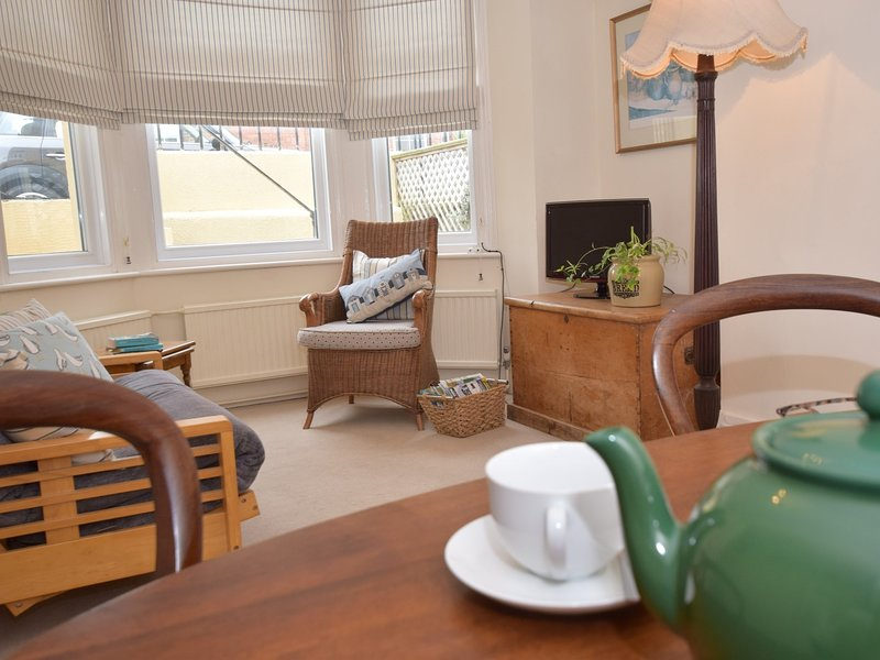 Pretty downstairs lounge in this seaside cottage
