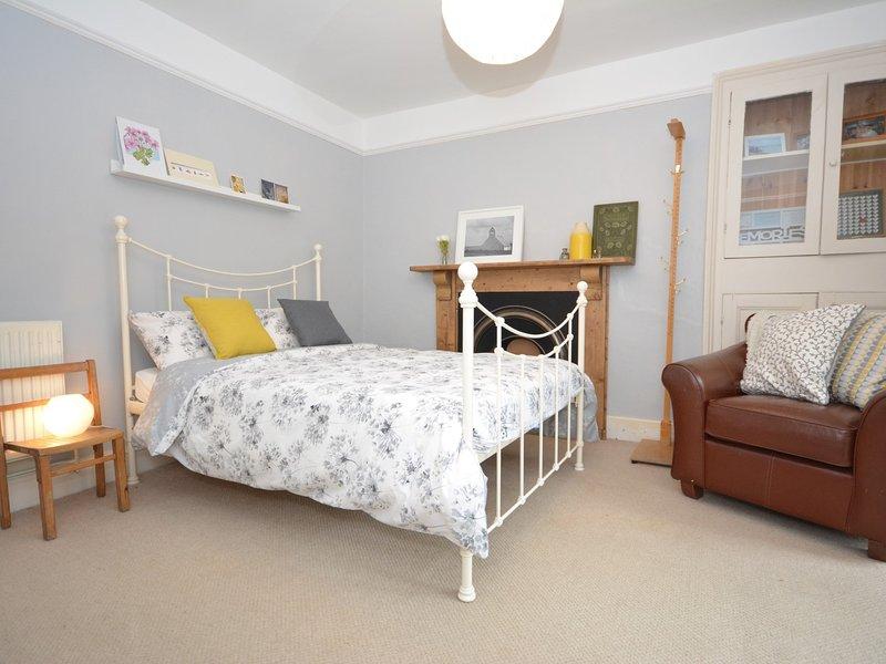Ground floor double bedroom with doors to rear garden