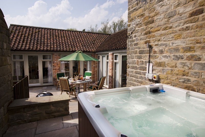 Outside seating area and private hot tub