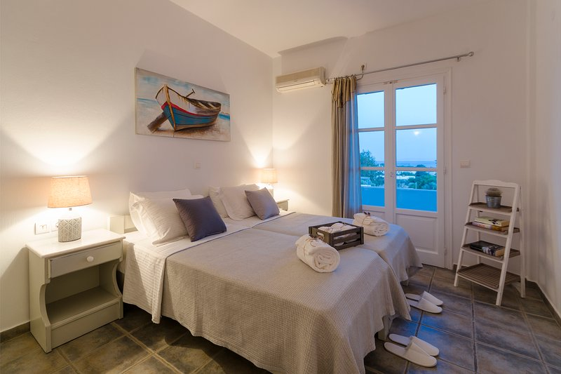 Large double bedroom with a big, sun protected by pergola ,balcony to enjoy the panoramic sea view!