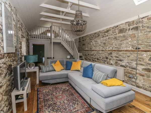 Mezzanine bedroom overlooking open plan living area