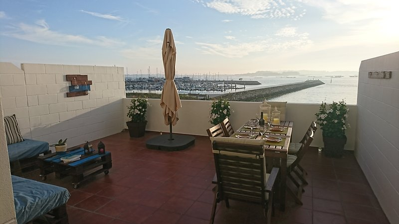 exclusive and private terrace fully equipped almost above the sea. panoramic view of the estuary.
