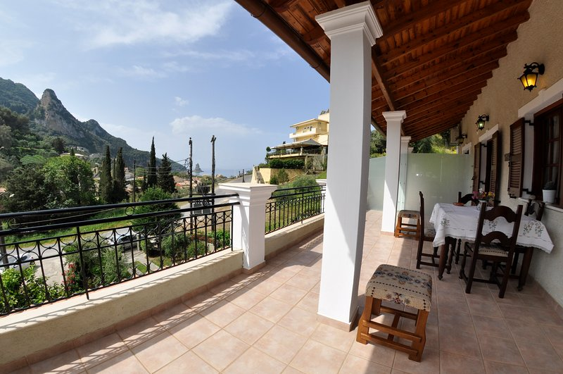 large terrace w sea and mountain views
