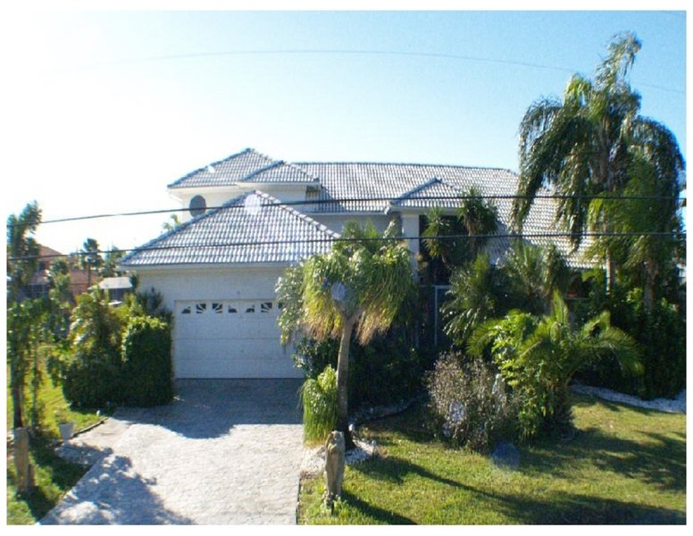 FRONT VIEW OF direct Gulf access waterfront 2 story 5 bedroom 3.5 bath VILLA GRANDEE..