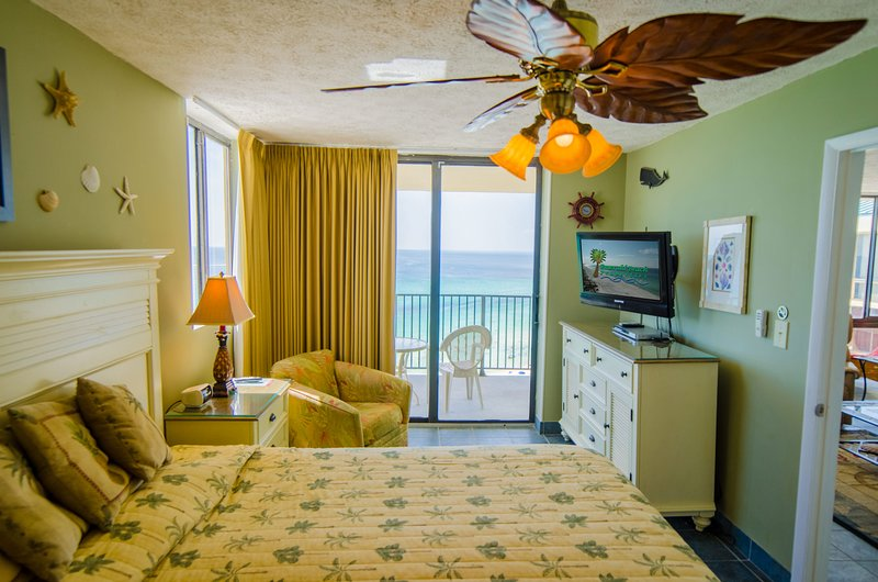 The king sized master bedroom opens on to the balcony overlooking the beach.