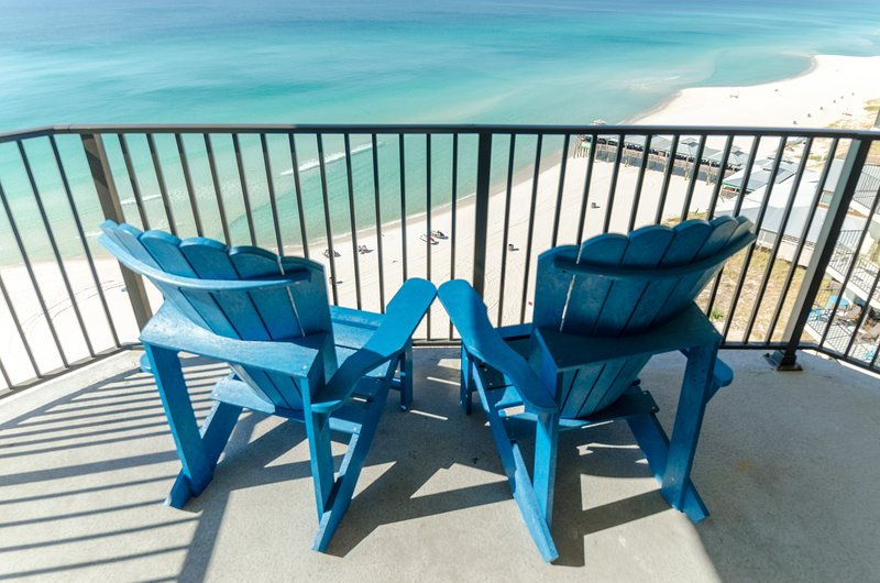 Enjoy a little shade while you watch the gentle waves.  The balcony has a table and plenty of chairs for al fresco dining.