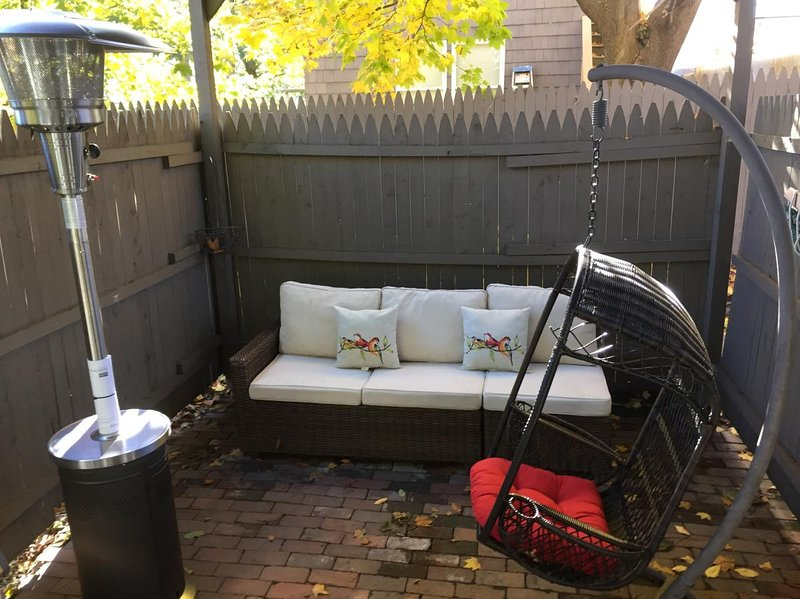 Private and enclosed Red-Brick, heated porch with a grill.