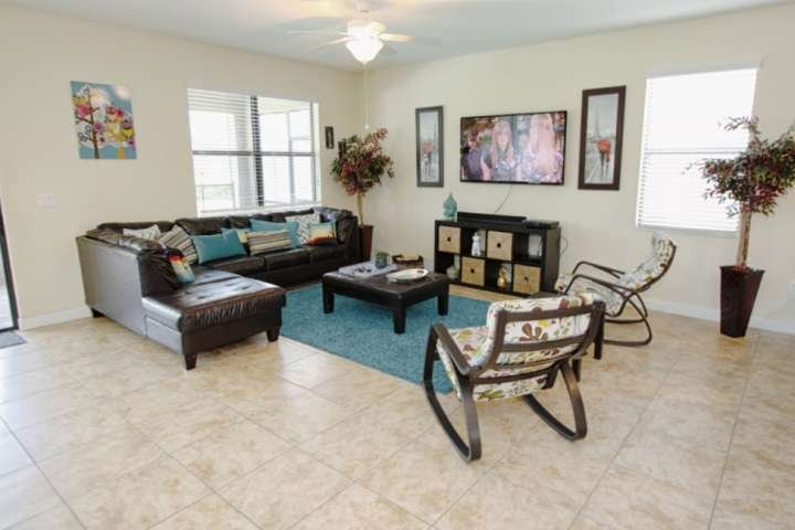 Spacious Living Area w/ Leather Seating, 60' Flat Screen TV, DVD Player & Private Pool Area Access