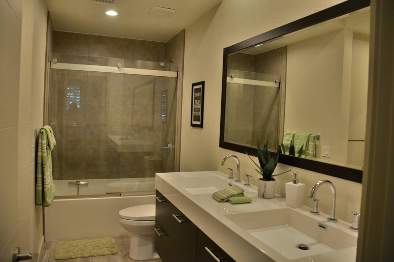 Bathroom # 1 with double sinks and tub shower combo