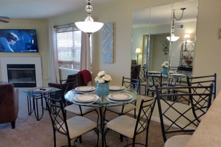 Dining Room/Living Room Area. Table/Chairs for Four. Breakfast Bar Seating for Two.