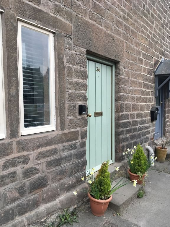 Front of property with traditional Cromford style door