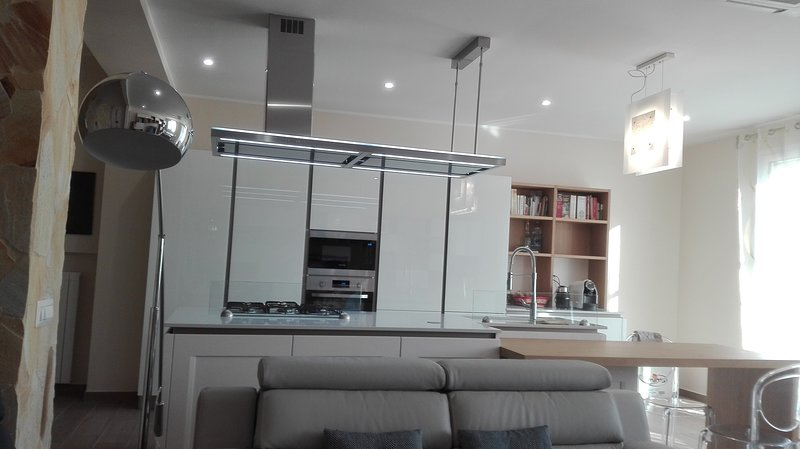 kitchen with island. Oven and microwave, and coffee, cappuccino, chocolate and ginseng.